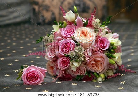Wedding bouquet from pink roses close up