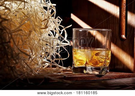 Glass Of Whiskey And Ice.in Wooden Container For Transporting With Wooden Chips. Horizontal Shot