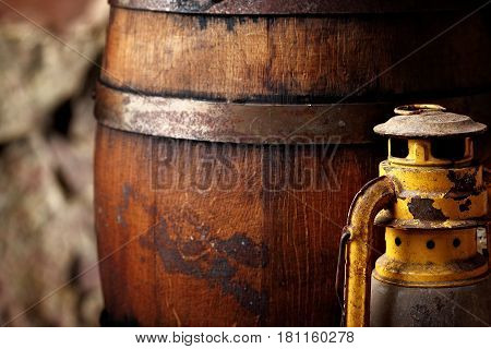 Old Fashioned Light Kerosene Lantern Style Oil Lamp And Barrels.closeup