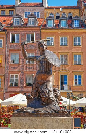 Warsaw, Poland - August 20, 2012: Bronze statue of Mermaid in the Old Town Market Place in Warsaw Poland