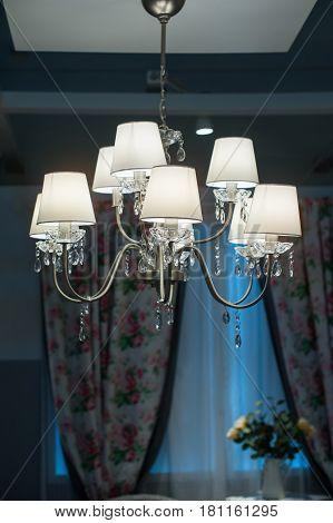 decorative designer chandelier on a dark background.