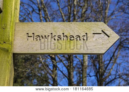 A sign pointing towards the direction of Hawkshead in the Lake District in Cumbria UK.