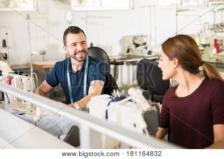 Workers Talking In A Textile Factory