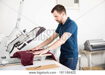 Man Using A Serigraph Press