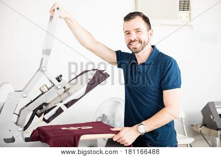 Handsome Worker Using A Serigraph Press