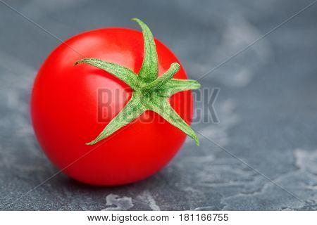 tomat red on a black stone ripe beautiful