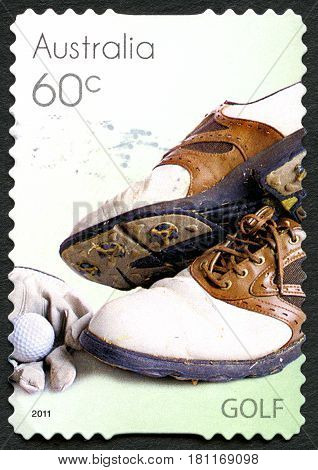 AUSTRALIA - CIRCA 2011: A used postage stamp from Australia depicting an image of Golf shoes gloves and Golf ball circa 2011.