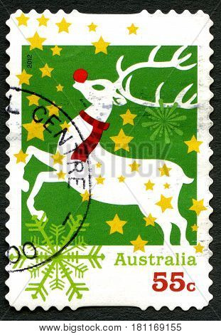 AUSTRALIA - CIRCA 2012: A used postage stamp from Australia depicting an illustration of Rudolph the red-nosed Reindeer celebrating Christmas circa 2012.