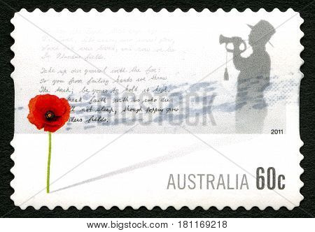 AUSTRALIA - CIRCA 2011: A used postage stamp from Australia depicting an illustration of a red poppy and words from the poem In Flanders Fields circa 2011.