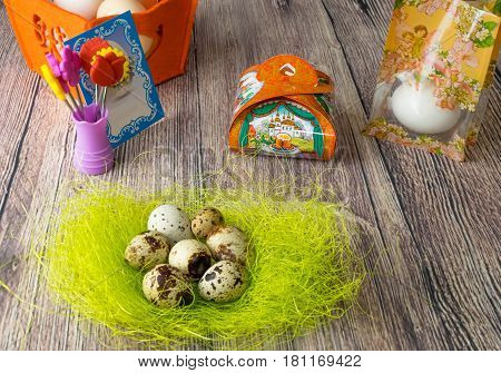 colored Easter egg decorated on the table in the holiday of light Christ is Risen in different colors and pictures for eggs