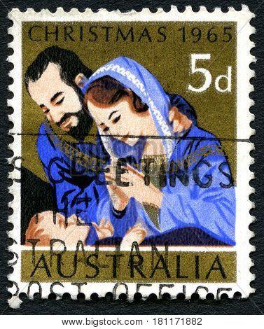 AUSTRALIA - CIRCA 1965: A used postage stamp from Australia depicting a festive Christmas illustration of Mary Joseph and baby Jesus circa 1965.