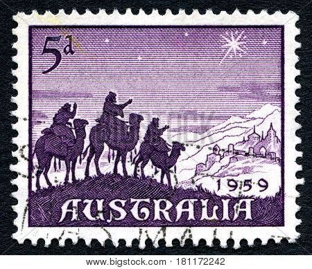 AUSTRALIA - CIRCA 1959: A used postage stamp from Australia depicting a festive nativity illustration of the three wise men following the Star of Bethlehem circa 1959.