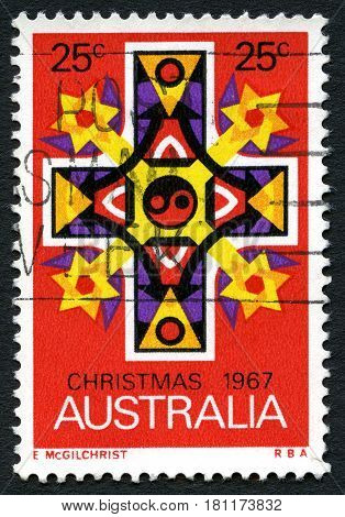 AUSTRALIA - CIRCA 1967: A used postage stamp from Australia depicting a biblical cross commemorating Christmas circa 1967.