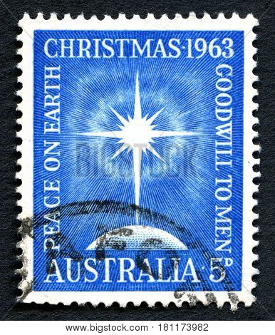 AUSTRALIA - CIRCA 1963: A used postage stamp from Australia depicting an illustration of a festive star to commemorate Christmas circa 1963.
