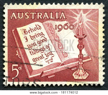 AUSTRALIA - CIRCA 1960: A used postage stamp from Australia depicting a religious message from Luke 2:10 to celebrate Christmas circa 1960.