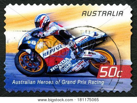 AUSTRALIA - CIRCA 2004: A used postage stamp from Australia celebrating Australian Heroes of Grand Prix Racing with an image of Mick Doohan circa 2004.