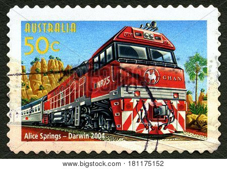 AUSTRALIA - CIRCA 2004: A used postage stamp from Austraia celebrating The Ghan Passenger Train Service between Alice Springs and Darwin circa 2004.