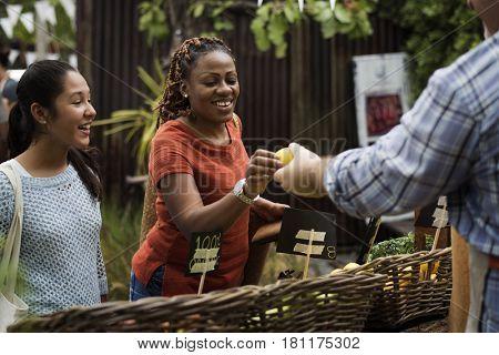 Woman Buying Fresh Local Vegetable at Farmer Market