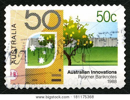 AUSTRALIA - CIRCA 2004: A used postage stamp from Australia celebrating Australian Innovations - this one commemorating Polymer Banknotes circa 2004.