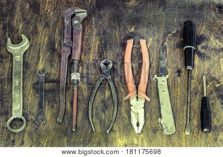 Old toolSet of an old instrument on a wood background