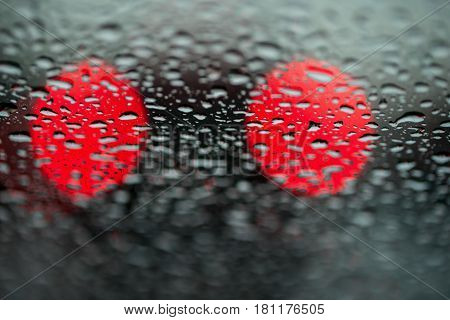Abstract background for the banner. Two night lights of city transport were seen through the windshield in rainy weather. Concept of threat, danger, hazard, peril, menace, jeopardy, imminence