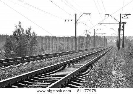 Rail road tracks in the countryside. Black and white.