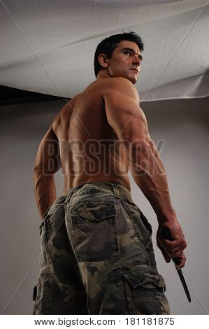 The muscular marine is ready for battle.