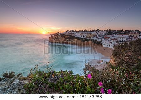 The seascape of Carvoeiro at sunset in a long exposure. Algarve Portugal