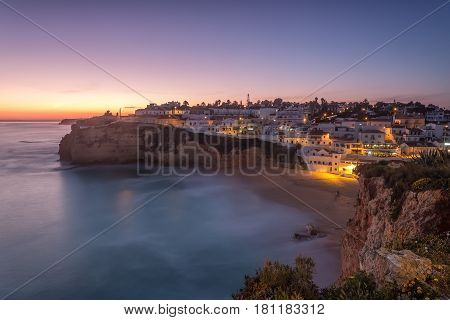 Seascape of Carvoeiro at night in the lights. Portugal