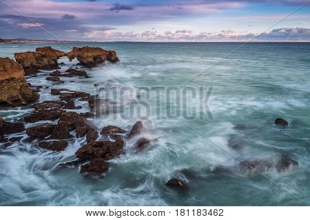 A dramatic landscape on the rocks on the beach in Albufeira. Portugal