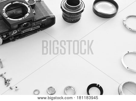 Details Of The Old Manual Lens In The Frame, Free Space. Laid Lens Disassembled In A Circle On A Whi