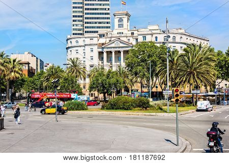 Barcelona Spain - June 6 2016: City streets and pedestrians near The Naval Sector of Catalonia a government building which occupies the site of the former headquarters of the shipyards in Barcelona.