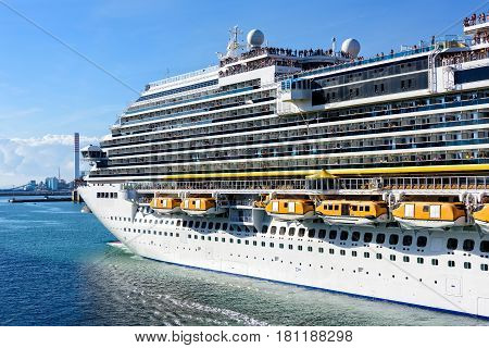 Cruise ship filled with passengers departs the Port of Rome in Italy.