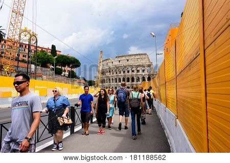 Rome Italy - June 10 2016: Busy street filled with pedestrians in Rome which leads to the landmark Colosseum in Italy.