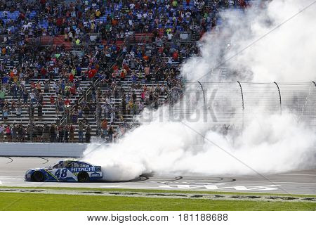April 09, 2017 - Ft. Worth, Texas, USA: Jimmie Johnson (48) performs a burnout after winning the O'Reilly Auto Parts 500 at Texas Motor Speedway in Ft. Worth, Texas.