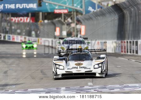 April 07, 2017 - Long Beach, California, USA:  The Mustang Sampling Racing Cadillac DPI car races through the turns at the Bubba Burger Sports Car Grand Prix At Long Beach in Long Beach, California.