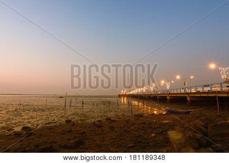 Coast and bridge of Chonburi province in the evening light twilight at Thailand.
