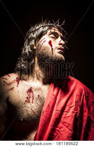 Jesus Christ struck and bleeding with crown of thorns during the passion