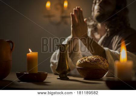 Jesus christ holding prayer to god father at his last supper