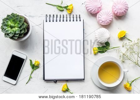 woman office desk with notebook and flowers in spring desing on white marble desk background top view mockup