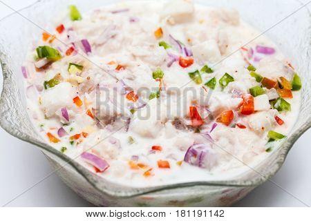 Peruvian ceviche preparation : White fish Peruvian ceviche in a transparent bowl