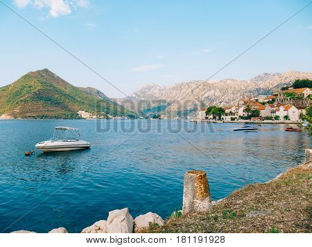 The old town of Perast on the shore of Kotor Bay, Montenegro. The ancient architecture of the Adriatic and the Balkans. Fishermen's cities of Europe.