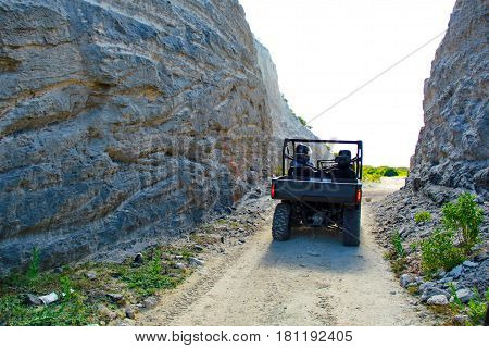 Buggy on the road inside the rocks