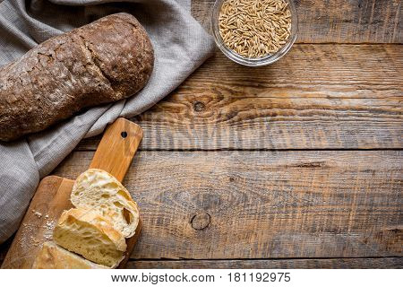 bakery concept with homemade fresh rye bread on rustic kitchen table background top view moke-up
