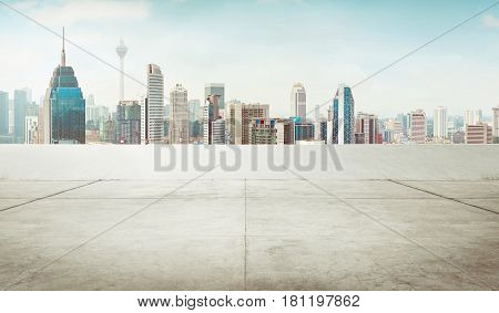 Empty cement roof top with modern city skyline .