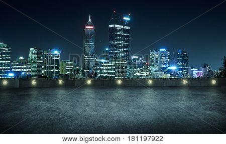 Empty asphalt roof top with modern city skyline night scene Perth Australia .
