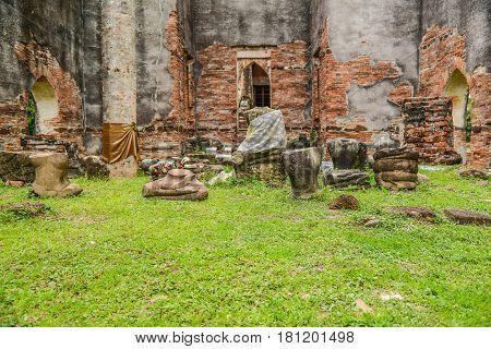 Broken Buddha image in King Narai the king during Ayuthaya era Palace travel destinarion in Lopburi Thailand