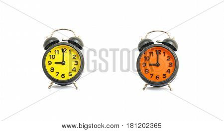 Closeup yellow alarm clock and orange alarm clock for decorate in 9 o'clock isolated on white background