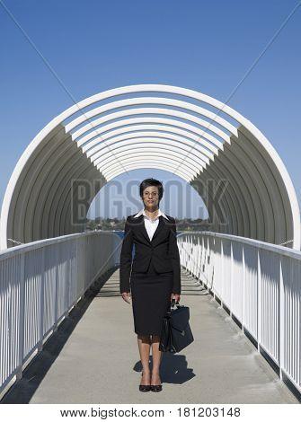 Mixed Race businesswoman on walkway