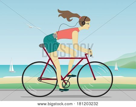 Attractive carefree young woman riding bicycle and listening to music near the sea